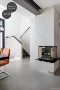 Mikrozement fugenlose Futado Wand und Bodenbeschichtung im Wohnzimmer - Juragrau FU-107